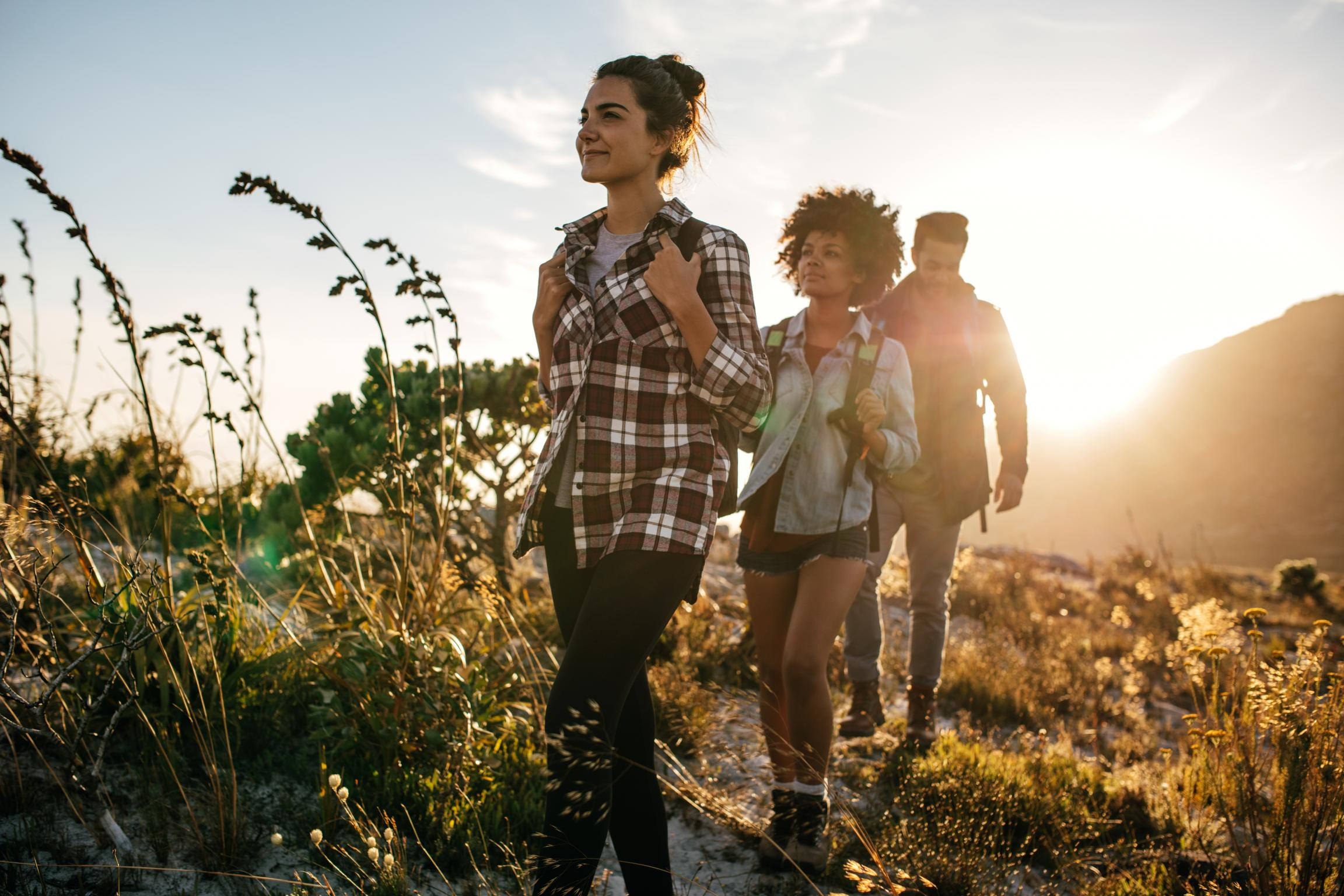 Group of young people hiking on a trail